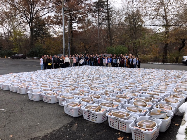 Key Club along with some of the 600 baskets assembled
