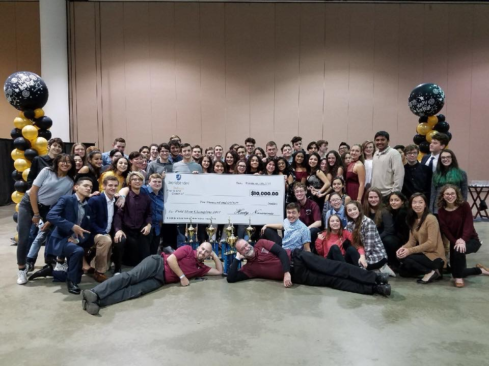NHS marching band poses for a picture with the check, photo: Nutley Music Boosters website