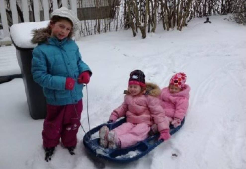 My sisters and I playing in the snow when we were younger on a snowday.