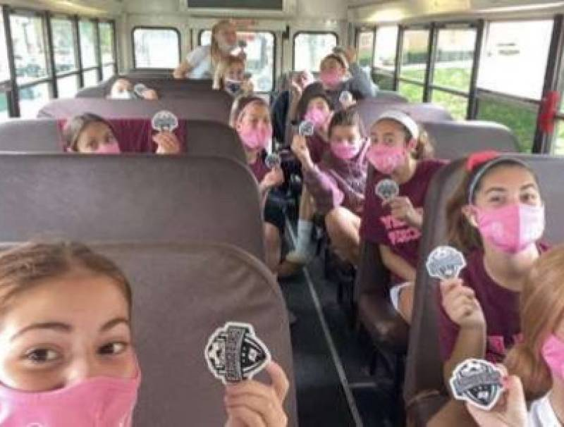 Nutley Girls Soccer team masked up, each sitting in their own row on the bus to ensure safety.