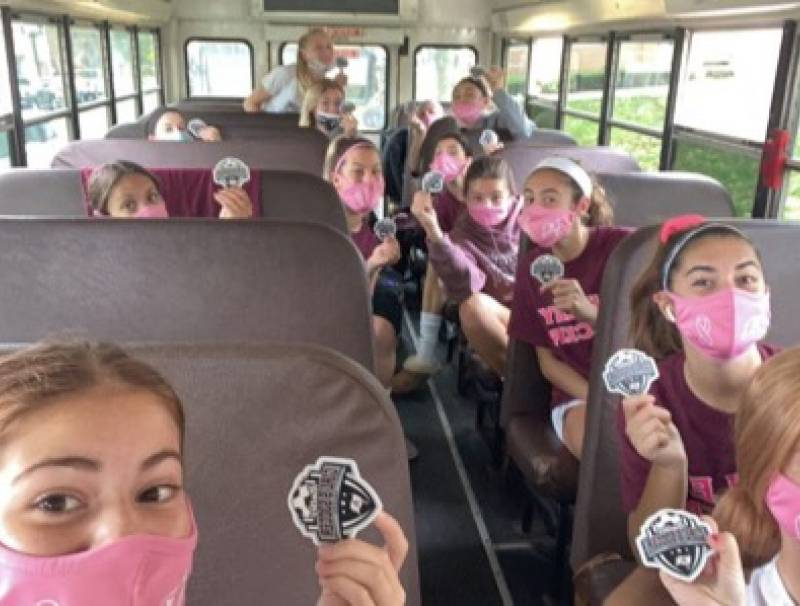 The girls on the way to their game all masked up!